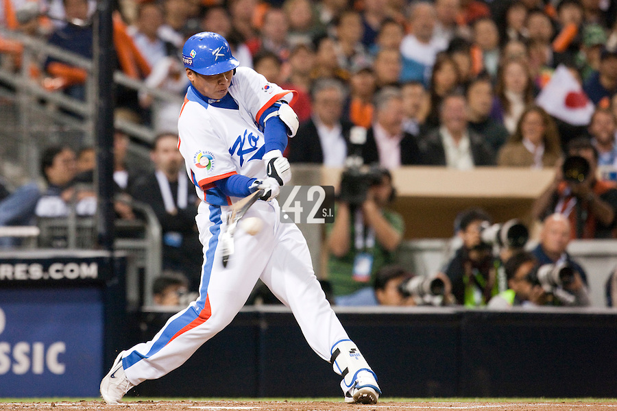 17 March 2009: #6 Bum Ho Lee of Korea makes contact and breaks his bat on  during the 2009 World Baseball Classic Pool 1 game 4 at Petco Park in San Diego, California, USA. Korea wins 4-1 over Japan.