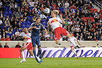 Todd Dunivant (2) of the Los Angeles Galaxy and Stephen Keel (22) of the New York Red Bulls go up for a header. The New York Red Bulls defeated the Los Angeles Galaxy 2-0 during a Major League Soccer (MLS) match at Red Bull Arena in Harrison, NJ, on October 4, 2011.