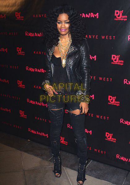 "TEYANA TAYLOR.Los Angeles Premiere of ""Runaway"" held at Harmony Gold Preview House, Los Angeles, California, USA..October 18th, 2010.full length black jeans denim ripped torn leather jacket lace top open toe boots shoes hand in pocket gold necklaces .CAP/ADM/TC.©T. Conrad/AdMedia/Capital Pictures."