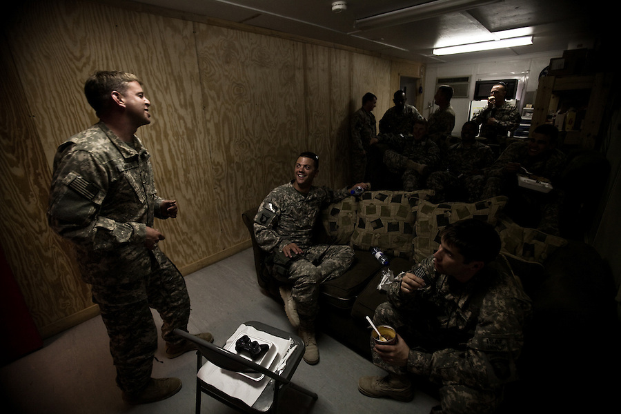 "Pilots, medics, and crew chiefs share a laugh in one of Charlie Company's ready-rooms. Scenes from the medical evacuations of wounded Americans, Canadians, and Afghan civilians and soldiers being flown by Charlie Co. 6th Battalion 101st Aviation Regiment of the 101st Airborne Division. Charlie Co. - which flies under the call-sign ""Shadow Dustoff"" - flies into rush the wounded to medical care out of bases scattered across Oruzgan, Kandahar, and Helmand Provinces in the Afghan south. These images were taken of missions flown out of Kandahar Airfield in Kandahar Province and Camp Dwyer in Helmand Province."