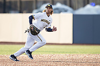 Michigan Wolverines first baseman Jordan Brewer (22) on defense against the Western Michigan Broncos on March 18, 2019 in the NCAA baseball game at Ray Fisher Stadium in Ann Arbor, Michigan. Michigan defeated Western Michigan 12-5. (Andrew Woolley/Four Seam Images)