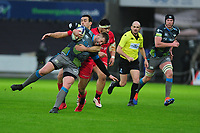 Scott Otten of Ospreys is tackled by Alex Lozowski of Saracens during the Heineken Champions Cup Round 5 match between the Ospreys and Saracens at the Liberty Stadium in Swansea, Wales, UK. Saturday January 11 2020.