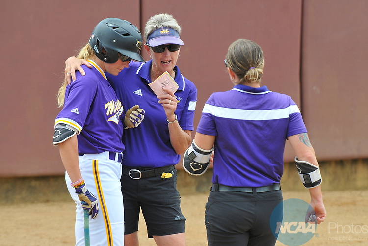 SALEM, VA - MAY 29:  Head Coach Lori Meyer of Minnesota State University talks to her team against Angelo State University during the Division II Women's Softball Championship held at Moyer Park on May 29, 2017 in Salem, Virginia. Minnesota State defeated Angelo State 5-1 to win the national championship. (Photo by Andres Alonso/NCAA Photos via Getty Images)