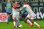 15.02.2020, Merkur Spiel-Arena, Duesseldorf, GER, 1. BL, Fortuna Duesseldorf vs. Borussia Moenchengladbach, DFL regulations prohibit any use of photographs as image sequences and/or quasi-video<br /> <br /> im Bild / picture shows: v. li. im Zweikampf Erik Thommy (#15, Fortuna Duesseldorf) Marcus Thuram  (#10, Borussia Moenchengladbach) Zanka (#19, Fortuna Duesseldorf) <br /> <br /> Foto © nordphoto/Mauelshagen