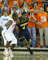 Nov 30, 2010; Clemson, SC, USA; Michigan Wolverines Darius Morris (4) drives around Clemson guard Andre Young (11) in the game against the Clemson Tigers at Littlejohn Coliseum. Mandatory Credit: Daniel Shirey/WM Photo -US PRESSWIRE