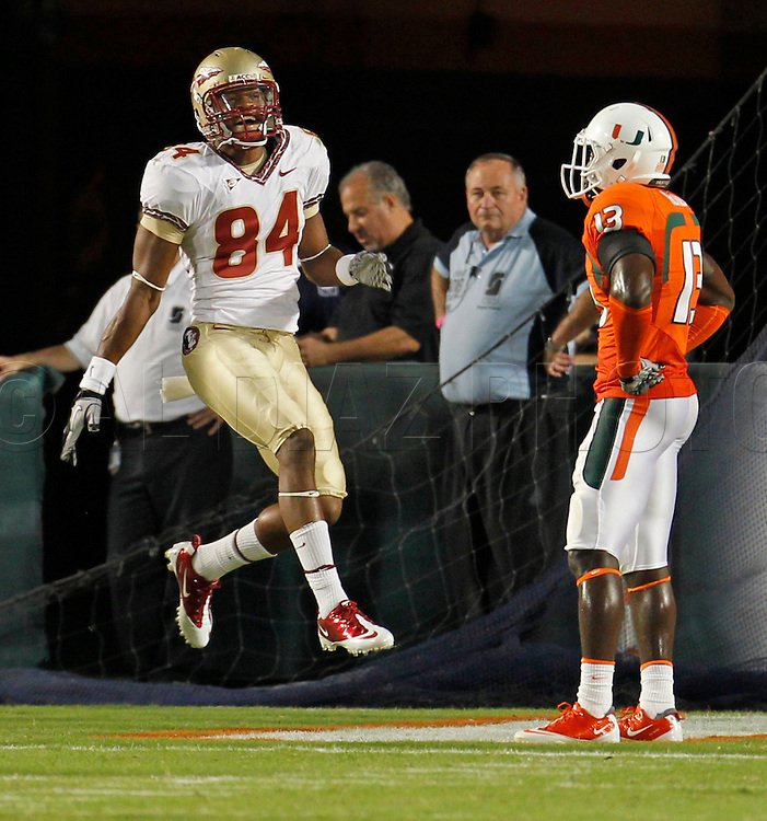 Seminoles Rodney Smith celebrates in the endzone after scoring in the fourth quarter as Miami's Ryan Hill watches during the University of Miami vs Florida State University on Saturday October 9, 2010.