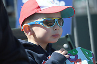 NWA Democrat-Gazette/J.T. WAMPLER Alex Grotts, 4, eats popcorn while watching the Northwest Arkansas Naturals play San Antonio Tuesday April 10, 2018 at Arvest Ballpark in Springdale. Tuesday was Education Day at the ballpark with several hundred school children bussed in for the game. The Naturals are back at home against the Drillers on Thursday April 19. Alex was at the same with his dad Zech Grotts ((CQ)) of Lowell.