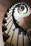 """Haldon Belvedere, Exeter, Devon..Photo shows the spiral staircase that winds itself up to the roof terrace at Haldon Belvedere. Built in 1788 by celebrated English cleric and politician Sir Robert Palk, the striking triangular structure, whose three points are marked by identical turret-topped towers, was visited by King George III, albeit late in his reign when he was suffering from an incurable mental illness. The construction of a local carriageway, simply called """"King's Road,"""" predates that visit, indicating that Palk probably had such a brush with royalty in mind. The building is today used as accommodation and wedding venue."""