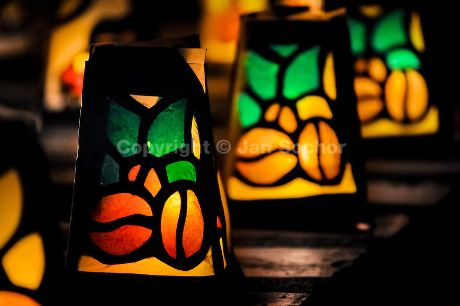 Colorful paper lanterns, depicting coffee beans, are seen shining on the street during the annual Festival of Candles and Lanterns in Quimbaya, Colombia, 8 December 2013. A vibrant event, celebrated since 1982 and attracting tens of thousands of visitors every year, is held in honor of the Virgin Mary, on the day of the Catholic Feast of the Immaculate Conception. Each street and neighborhood in the town compete in the contest to create the most spectacular lighting arrangement of their place, employing creatively elaborated lantern designs, which range from religious themes, to symbols of the coffee region or the environmental and wild nature motives. All the streets in Quimbaya center close for one night and some 40,000 lanterns are being lightened up at the festive night.