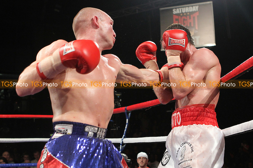 Gavin Rees (blue/red shorts) beats John Watson (White shorts)  in a lightweight boxing contest at the Newport Leisure Centre, Wales, promoted by Matchroom Sports - 06/11/10 - MANDATORY CREDIT: Chris Royle/TGSPHOTO - Self billing applies where appropriate - 0845 094 6026 - contact@tgsphoto.co.uk - NO UNPAID USE..
