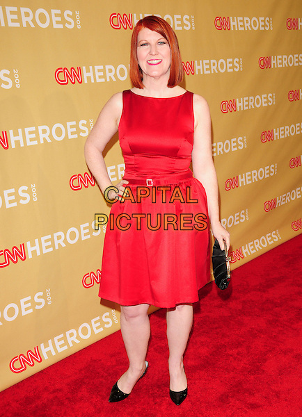 KATE FLANNERY .at The 3rd Annual CNN Heroes: An All-Star Tribute held at The Kodak Theatre in Hollywood, California, USA,  November 21st 2009                                                                   .full length sleeveless red dress hand on hip black shoes clutch bag waist belt .CAP/RKE/DVS.©DVS/RockinExposures/Capital Pictures