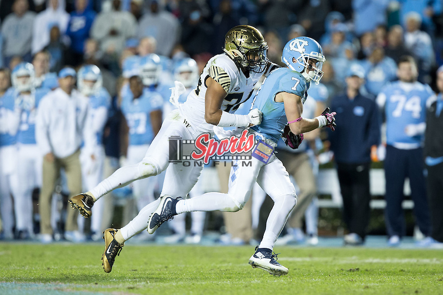 Austin Proehl (7) of the North Carolina Tar Heels is tackled from behind by Demetrius Kemp (34) of the Wake Forest Demon Deacons during second half action at Keenan Stadium on October 17, 2015 in Chapel Hill, North Carolina.  The Tar Heels defeated the Demon Deacons 50-14.   (Brian Westerholt/Sports On Film)