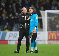 Blackpool's goalkeeping coach Dave Timmins with Blackpool's Michael Nottingham at the end of the game<br /> <br /> Photographer Chris Vaughan/CameraSport<br /> <br /> The EFL Sky Bet League One - Burton Albion v Blackpool - Saturday 16th March 2019 - Pirelli Stadium - Burton upon Trent<br /> <br /> World Copyright &copy; 2019 CameraSport. All rights reserved. 43 Linden Ave. Countesthorpe. Leicester. England. LE8 5PG - Tel: +44 (0) 116 277 4147 - admin@camerasport.com - www.camerasport.com