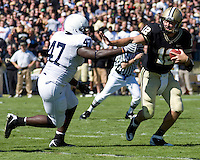 October 03, 2008: Penn State defensive end Josh Gaines (47) closes in on Purdue quarterback Curtis Painter. The Penn State Nittany Lions defeated the Purdue Boilermakers 20-06 on October 03, 2008 at Ross-Ade Stadium, West Lafayette, Indiana.