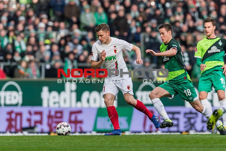 10.02.2019, Weserstadion, Bremen, GER, 1.FBL, Werder Bremen vs FC Augsburg<br /> <br /> DFL REGULATIONS PROHIBIT ANY USE OF PHOTOGRAPHS AS IMAGE SEQUENCES AND/OR QUASI-VIDEO.<br /> <br /> im Bild / picture shows<br /> Alfred Finnbogason (FC Augsburg #27) im Duell / im Zweikampf mit Niklas Moisander (Werder Bremen #18), <br /> <br /> Foto © nordphoto / Ewert