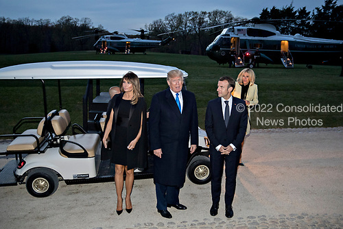 U.S. President Donald Trump speaks to members of the media next to a golf cart following a dinner with Emmanuel Macron, France's president, right, and U.S. First Lady Melania Trump, left, at the Mount Vernon estate of first U.S. President George Washington in Mount Vernon, Virginia, U.S., on Monday, April 23, 2018.  As Macron arrives for the first state visit of Trump's presidency, the U.S. leader is threatening to upend the global trading system with tariffs on China, maybe Europe too. <br /> Credit: Andrew Harrer / Pool via CNP
