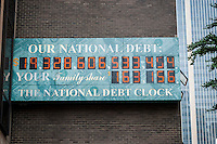 The National Debt Clock in New York  showing the US debt as over $19 trillion is seen on Friday, July 22, 2016.  Real-estate mogul, the late Seymour Durst, created the clock on Feb. 20, 1989 to call attention to  Reaganomics. (© Richard B. Levine)