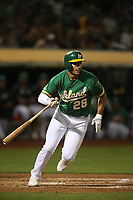 OAKLAND, CA - SEPTEMBER 6:  Matt Olson #28 of the Oakland Athletics bats against the Detroit Tigers during the game at the Oakland Coliseum on Friday, September 6, 2019 in Oakland, California. (Photo by Brad Mangin)