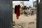A Palestinian girl sits next to her destroyed house, on a winter cold day, in Khan Youns southern in Gaza city January 20, 2020. Photo by Ashraf Amra