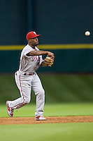 Philadelphia Phillies shortstop Jimmy Rollins #11 throws to first base during the Major League Baseball game against the Houston Astros at Minute Maid Park in Houston, Texas on September 12, 2011. Houston defeated Philadelphia 5-1.  (Andrew Woolley/Four Seam Images)