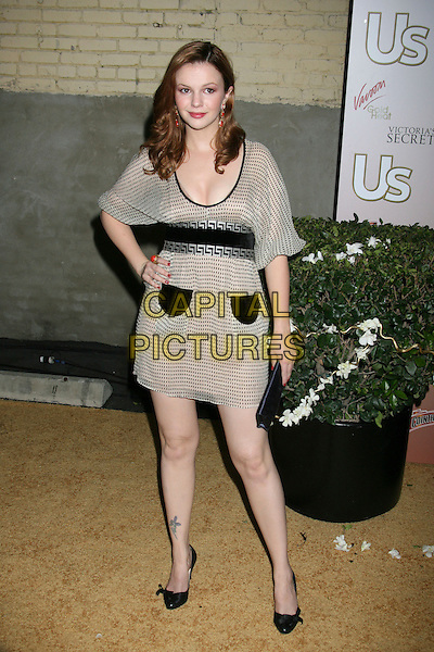 AMBER TAMBLYN.US Weekly Presents Us' Hot Hollywood 2007 held at Sugar,  Hollywood, California, USA..April 26th, 2007.full length black beige pockets tattoo polka dot dress clutch purse bag cream.CAP/ADM/RE.©Russ Elliot/AdMedia/Capital Pictures