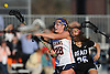 Rory Quinn #28 of Manhasset, left, shoots on goal under pressure from Daisy Willard #26 of Long Beach during the second half of a Nassau County varsity girls lacrosse game at Manhasset High School on Friday, Apr. 15, 2016. Manhasset won by a score of 9-8.