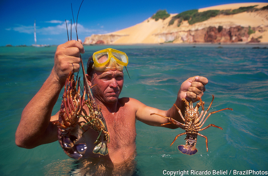 Sport lobster fishing with mask and snorkel, Ceara State coastline, tropical beach, Brazil.