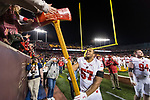 Wisconsin Badgers defensive lineman Alec James (57) celebrates with the Paul Bunyan Axe after an NCAA College Big Ten Conference football game against the Minnesota Golden Gophers Saturday, November 25, 2017, in Minneapolis, Minnesota. The Badgers won 31-0. (Photo by David Stluka)