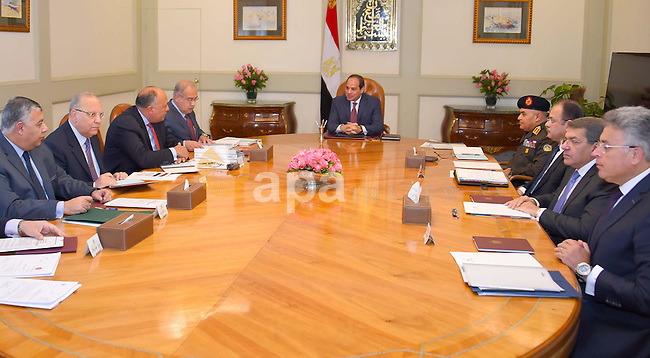 Egyptian President Abdel Fattah al-Sisi, meets with Prime Minister, Sherif Ismail, in Cairo, Egypt, on December 17, 2016. Photo by Egyptian President Office