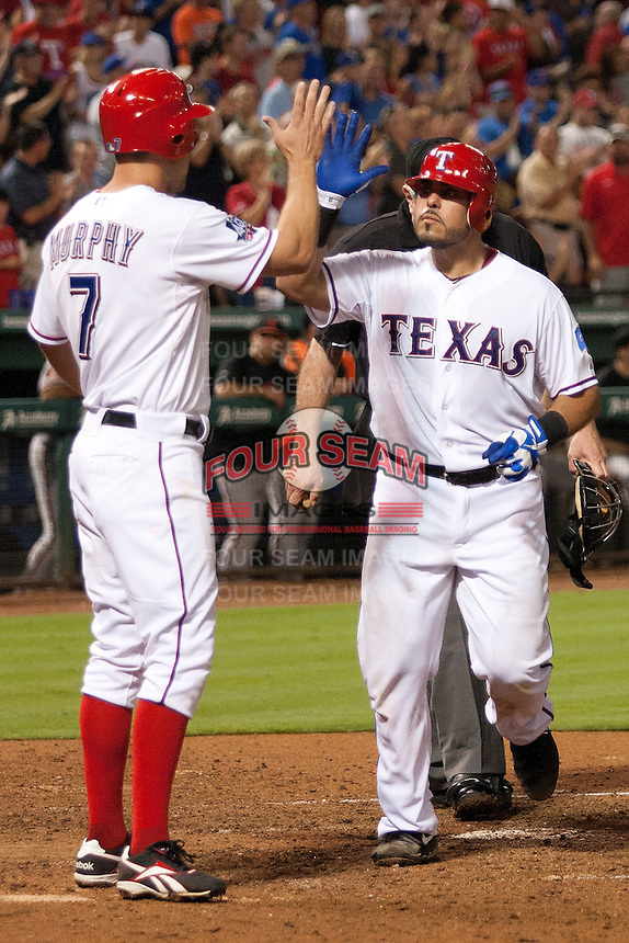 Texas Rangers catcher Geovany Soto #8 after homering during the Major League Baseball game against the Baltimore Orioles on August 21st, 2012 at the Rangers Ballpark in Arlington, Texas. The Orioles defeated the Rangers 5-3. (Andrew Woolley/Four Seam Images).