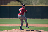 Arizona Diamondbacks relief pitcher Lane Ratliff (18) prepares to deliver a pitch during a Spring Training game against Meiji University at Salt River Fields at Talking Stick on March 12, 2018 in Scottsdale, Arizona. (Zachary Lucy/Four Seam Images)