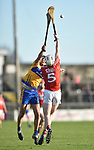 Cathal Malone of Clare in action against Chris O Leary of Cork during their Munster Hurling League game at Cusack Park. Photograph by John Kelly.