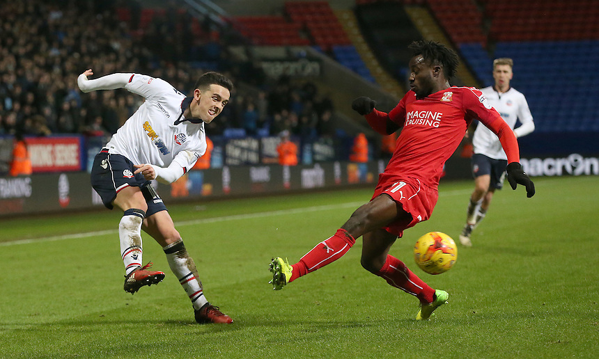 Bolton Wanderers' Zach Clough crosses the ball despite the attentions of Swindon Town's Sheik Mohamed Fankaty Dabo<br /> <br /> Photographer Stephen White/CameraSport<br /> <br /> The EFL Sky Bet League One - Bolton Wanderers v Swindon Town - Saturday 14th January 2017 - Macron Stadium - Bolton<br /> <br /> World Copyright &copy; 2017 CameraSport. All rights reserved. 43 Linden Ave. Countesthorpe. Leicester. England. LE8 5PG - Tel: +44 (0) 116 277 4147 - admin@camerasport.com - www.camerasport.com