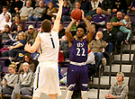 SIOUX FALLS, SD - DECEMBER 31: Justin Taylor #22 from the University of Sioux Falls spots up for a jumper over Matt Cartwright #1 from Augustana University during their game Sunday afternoon December 31, 2017 at the Stewart Center in Sioux Falls, SD.  (Photo by Dave Eggen/Inertia)