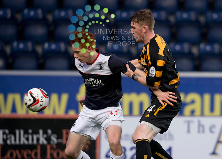 Scott Shepherd of Falkirk  holds off a challenge from Michael Doyle of Alloa  during the Scottish Championship match between Falkirk and Alloa at The Falkirk Stadium, Falkirk. 28 December 2013. Picture by Ian Sneddon / Universal News and Sport (Scotland). All pictures must be credited to www.universalnewsandsport.com. (Office) 0844 884 51 22.