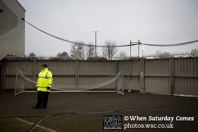 St Mirren 4 The New Saints 1, 19/02/2017. Paisley 2021 Stadium, Scottish Challenge Cup. A steward on duty during the first-half at the Paisley2021 Stadium as Scottish Championship side St Mirren (in white) played Welsh champions The New Saints in the semi-final of the Scottish Challenge Cup for the right to meet Dundee United in the final. The competition was expanded for the 2016-17 season to include four clubs from Wales and Northern Ireland as well as Scottish Premier under-20 teams. Despite trailing at half-time, St Mirren won the match 4-1 watched by a crowd of 2044, including 75 away fans. Photo by Colin McPherson.