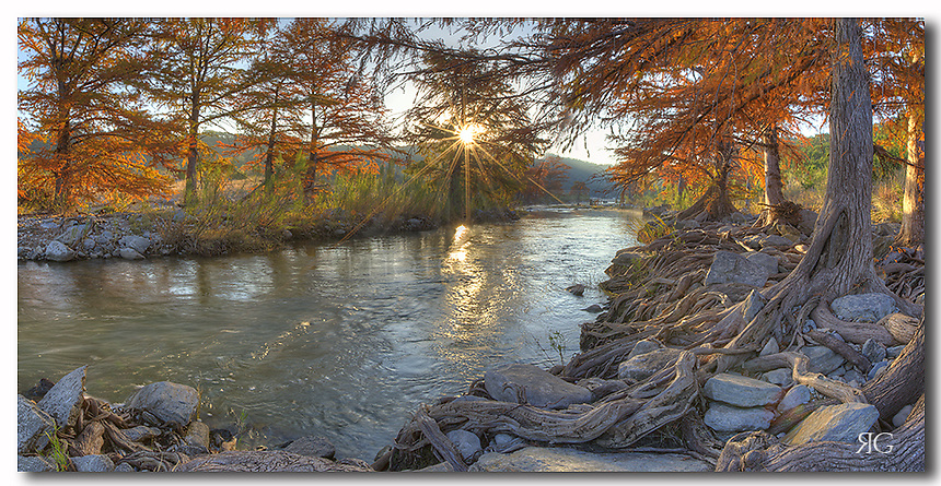 This Texas Hill Country Images comes from Pedernales Falls State Park. Autumn is a wonderful time to photograph the cypress along the riverbank as the leaves turn red and orange. In this morning panorama, the sun is just breaking over the horizon, filling the cold November air with a bit of warmth. This panorama is several images stitched together to create a wide angle print of this beautiful scene.