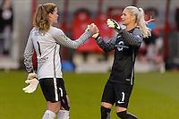 Bridgeview, IL, USA - Sunday, May 1, 2016: Chicago Red Stars goalkeeper Alyssa Naeher (1) and Orlando Pride goalkeeper Ashlyn Harris (1) after a regular season National Women's Soccer League match between the Chicago Red Stars and the Orlando Pride at Toyota Park. Chicago won 1-0.