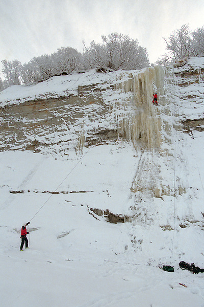 Ice climbers scale a cliff on the bluff above Cook Inlet near Ninilchik. The Kenai Peninsula is a playground of activity in the summer, but it is also an ideal location for winter sports and recreation.