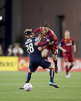 Real Salt Lake midfielder Ned Grabavoy (20) charges through New England Revolution defender Pat Phelan (28). Real Salt Lake defeated the New England Revolution, 2-1, at Gillette Stadium on October 2, 2010.