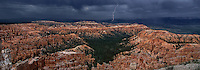 904000010 panoramic view of a monsoon summer storm with rain clouds and lightning over the hoodoos of the silent city in bryce canyon national park in south central utah