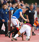 Suso Santana upends Kenny Miller off the side of the track who then retaliates against the Hearts man