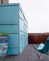 On the roof terrace the staircase opens from a copper clad box and there is an outdoor kitchen for rooftop parties