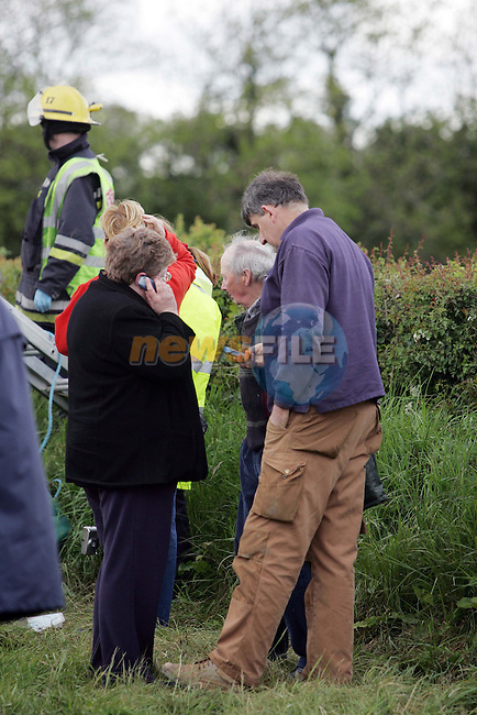 Navan Ireland, A Bus Eireann School Bus carring nearly 50 children home from School crashed and turned over after hitting two cars on the Kentstown Road outside Navan Co Meath, Information from the Scene Is 5 dead and numerous walking injured.Relatives wait to hear word from the scene..Photo NEWSFILE/FRAN CAFFREY..(Photo credit should read FRAN CAFFREY/NEWSFILE)...This Picture has been sent you under the condtions enclosed by:.Newsfile Ltd..the Studio,.Millmount Abbey,.Drogheda,.Co Meath..Ireland..Tel: +353(0)41-9871240.Fax: +353(0)41-9871260.GSM: +353(0)86-2500958.email: pictures@newsfile.ie.www.newsfile.ie.FTP: 193.120.102.198..This picture is from Fran Caffrey@newsfile.ie