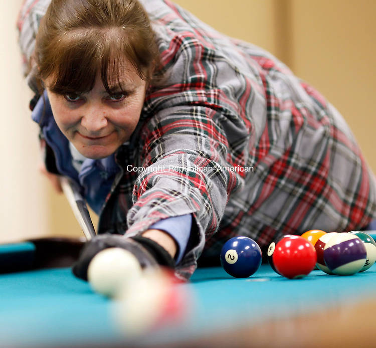 Naugatuck, CT- 10, January 2010-011011CM02 Claudette Soden of Naugatuck lines up a shot while playing pool with friends, Vic and Ceil Kowalchick Monday  afternoon at the Naugatuck Senior Center. The trio were enjoying a day in from the cold weather, which is supposed to continue today.  According to the National Weather Service, a winter storm is moving it's way to our area, and is expected to dump more then a foot of snow in some areas.  Christopher Massa Republican-American