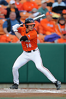 Virginia Cavaliers center fielder Brandon Downes #10 swings at a pitch during a game against the Clemson Tigers at Doug Kingsmore Stadium on March 15, 2013 in Clemson, South Carolina. The Cavaliers won 6-5.(Tony Farlow/Four Seam Images).