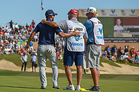 Andrew Landry (USA) hugs his caddie after sinking his par putt on 18 to win Valero Texas Open, AT&amp;T Oaks Course, TPC San Antonio, San Antonio, Texas, USA. 4/22/2018.<br /> Picture: Golffile | Ken Murray<br /> <br /> <br /> All photo usage must carry mandatory copyright credit (&copy; Golffile | Ken Murray)