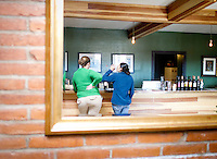 1/2/2011-  Amy Close, left, and Lesley Trujillo, right, taste wine a the tasting room in Dos Cabezas Wineworks in Sonoita, Arizona. (Photo by Pat Shannahan)
