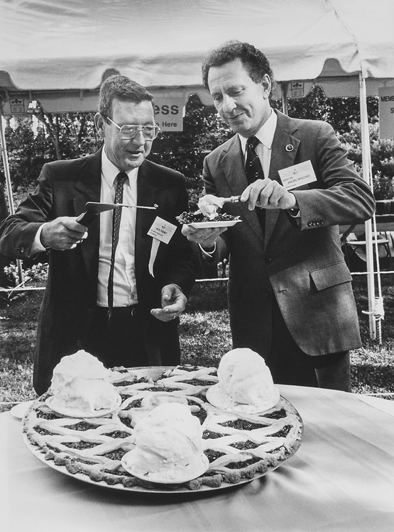 Jack Feeney, President of Mrs. Smith and Sen. Arlen Specter, R-Pa., scooping ice cream on to big cherry pie in June 1989. (Photo by Laura Patterson/CQ Roll Call via Getty Images)