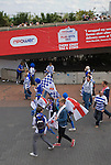A group of Reading fans walking towards the stadium on the day of the Npower Championship play-off final between Reading (blue) and Swansea City at Wembley Stadium. The match was won by Swansea by 4 goals to 2 watched by a crowd of 86,581. Swansea became the first Welsh team to reach the top division of English football since they themselves played there in 1983.